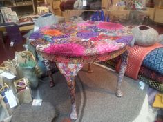 Here's a really beautiful decoupage table made using a vintage furniture piece covered in reclaimed fabric, and varnished to make it a practical artwork. By Refreshed Fabric Art, a new craft outfit in Cumbria