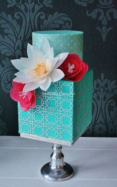 Stunning round and square blue cake with wafer paper flowers and patterns - Sweetlake Cakes