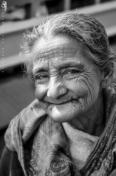 Smile, elderly woman, old lady, wrinckles, lines of life, powerful face, intense eyes, expression, portrait, b/w