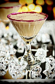 ☆ Glitter Godiva Mudslide Martini:  2 ounces chilled Godiva Chocolate Vodka,  2 ounces chilled Bailey's Irish Cream liquor,  1 ounce cold milk,  2 scoops vanilla ice cream,  2 Tablespoons Chocolate Syrup,  Place all ingredients into a blender. Blend until smooth. Pour into martini glasses. If desired, dust rim with edible glitter ☆.