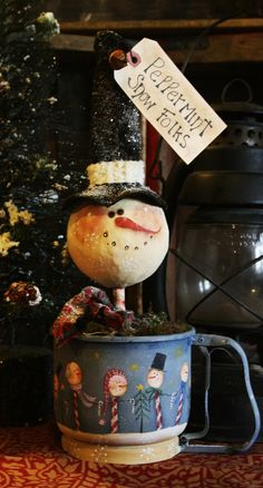 I found this vintage flour sifter in one of my favorite vintage/antique stores. I painted it with a design by Terrye French and added a snowman make do made from a styro foam ball, wall mud and some magical snowflakes.
