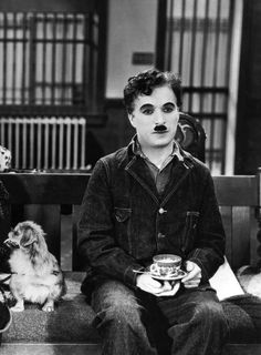 On set with Charles Chaplin with his Pekinese dog in Modern Times, Vevey, Charlie Chaplin, Old Movies, Great Movies, Vintage Hollywood, Classic Hollywood, Hollywood Video, People Drinking Coffee, Drinking Tea