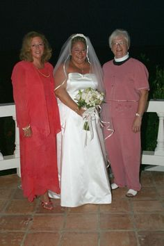 """""""Sandy's mom didn't get to plan her wedding, but she certainly stepped up to the plate to help finish all the little details when the wedding planner dropped the ball back in 2004"""" Left to right, Robin Corridon, Sandy, and Sandy's godmother the Rev. Nan Chandler."""