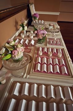 Vintage Escort Card Table - use picture frames to outline groups of people