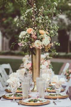tall gold centerpieces, photo by Amy Zumwalt Photography http://ruffledblog.com/dallas-arboretum-wedding #weddingideas #weddingcenterpieces