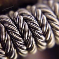Super-macro shot of my entry for the #CPbuildoff. This is the final pic I'm posting for this build. Let's close the series out with a dry-fire vid... Coming right up!  For specs and info please check out the first post of this build.  _____________________________________  #cleanbuilds • #cloudchasing • #coilart • #coilporn • @coilporn • #coil • #subohm • #vapecommunity • #vape • #vaping • #vapefam • #vapelife • #vapelyfe • #vapebuild • #vapenation • #vapepics • #vapeporn • #vapedaily •…