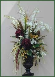 Our romantic mediterranean-style silk floral arrangements burst lively color in any room. Designer artificial flower creations hand-made to order.