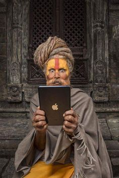 a sadhu and technology, India Goa India, We Are The World, People Around The World, Amazing India, India Culture, India People, India Travel, World Cultures, Beautiful Pictures