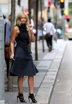 Model looks: Lara looked every inch the star as she posed in her chic ensemble of a silk skirt and wool top