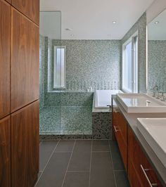 Mosaic Shower And Tub Tile Floor - The mosaic tile in the shower and bathroom differentiates zones in the space