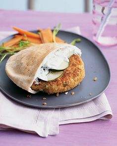 Greek-Style Quinoa Burgers  V  Mix nutty quinoa with great northern beans, scallions, carrot, and cumin to make these pan-fried veggie burgers. Serve in pita bread with lemony yogurt sauce and sliced cucumber. For the right consistency, use a thick Greek yogurt. You can prepare (but not cook) the burgers up to a day ahead, and then cover and refrigerate until you're ready to use.