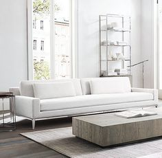 RH Modern's Italia Track Arm Sofa:Italian modernist design of the 1950s and '60s informs the simplified lines of our track-arm collection. Elegant in its minimalism, it's made welcoming with enveloping arms.