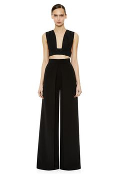 The Reloe high waist trousers in black feature a wide flared leg with box pleat front.   High waisted trousers with a wide waistband and concealed zip fastening at the back.  From the Summer Capsule Collection.