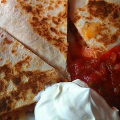Easy cheese quesadillas...  2 soft tortilla shells (wheat is also a great option); layer of mild cheddar on one half of the shell, jalepeno peppers, Pace mild salsa, another layer of Mexican mix shredded cheese. Fold over shells, place in moderate heated skillet. Brown on one side, flip over both shells, brown other side.     Cut each shell into three pieces. Serve immediately with sour cream and salsa. Tortilla Shells, Mild Salsa, Easy Cheese, Quesadillas, Skillet, Sour Cream, Cheddar, Pizza, Mexican