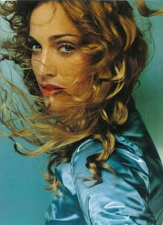 Madonna - Ray of Light. Obsessed with her locks and her dewy makeup since.