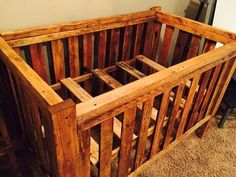 A gorgeous crib built entirely from pallet wood by Angry Wood Design.  #crib #pallet