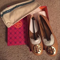 Tory Burch Authentic Revas! No low balling!! Reva Ballet tumbled leather shoes. AUTHENTIC!! Royal tan and gold. NWT and never worn! Bought for someone who decided they liked another style better. Was going to keep, but I already have this color in another style! So, these need to go. Original box & dust bag! Beautiful flats. Have other colors in this style (not for sale) and they are very comfortable and versatile. Dress up or down! Tory Burch Shoes Flats & Loafers