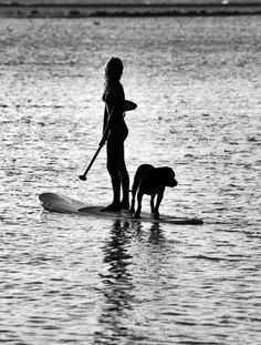 lifeasheimagined:    paddle boarding.  Would love to have my pup paddle boarding ;)