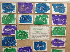 "Dinosaur Fossils: Children pretended to be paleontologist. Children made dinosaur rubbings using a white crayon, then they painted over using watercolors to uncover the ""magic"" dinosaur. Children then glued cotton swabs onto dinosaurs to represent dinosaur bones. Dinosaur Fossil craft #preschool #bulletinboard"