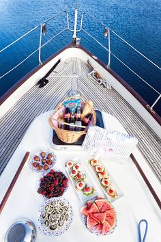 Enjoying a delicious array of snacks on the deck of a boat is one is the finer…