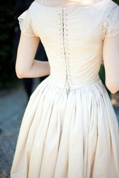 Historic Wedding Dress Here's a quick photo of my wedding dress, which is based on a German gown from 1862. I will post more photos of the dress once it returns from the cleaners! Construction Notes:...