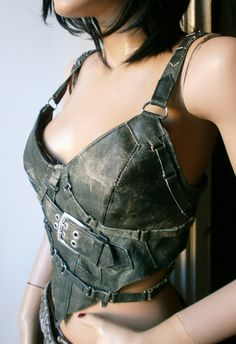 Worn out green leather corset top with buckles and straps all over. €115.00, via Etsy.