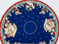 Imagen de http://www.aleydaosorio.com/01_images_productos/textiles/telas_navidenas/pie_de_arbol/2.jpg.