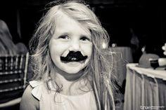 Mustache wearing flower girl #audrey #mustache #flowergirl #photobooth #wedding #lavalencia