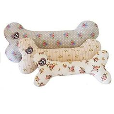 Use old jumpers or shirts to make cosy bed bone pillows for your furry friend.