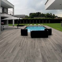 Can you believe this is a porcelain paver! Woodtalk plank tiles achieve that outdoor wood look featuring textured patterns with a modern planed finish in a porcelain pavers. Developed for zones with heavy traffic. Its thickness allows for sand insta Patio Tiles, Outdoor Tiles, Outdoor Flooring, Outdoor Pavers, Paver Deck, Paver Sand, Paver Edging, Pool Pavers, Paver Stones