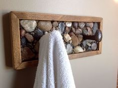 Rustic towel or coat rack Coat rack or towel rack made from railway spikes beach stone and rustic wood. The post Rustic towel or coat rack appeared first on Wood Ideas. Barn Wood, Rustic Wood, Rustic Decor, Stone Crafts, Wood Crafts, Rustic Furniture, Diy Furniture, Cheap Home Decor, Diy Home Decor