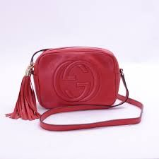 "$1,190.00 GUCCI - Gucci Leather Soho disco shoulder bag - women - SOLD by GUCCI - affiliate - A compact shoulder bag with a leather tassel zipper pull. Sized to fit the necessities. Made in our light, natural grain leather. Red leather Light gold-toned hardware   Leather tassel   Small size: 8""W x 6""H x 2.5""D  Cotton linen lining  Made in Italy"
