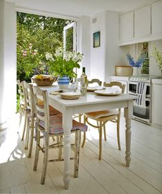 Dream kitchen would have this-- the wooden table opening up to the garden