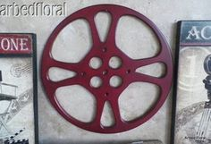 Home Theatre Decor - Doing this now!  Picked up old reels from eBay and spray painting them ... Very cool.