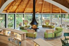 The adult's cone is centred around a fireplace surrounded by green modular sofas designed by Klein Dytham Architecture as part of its Dora Dora furniture collection, which was longlisted for a Dezeen Award in 2019. The central and adult cone both open out onto the terrace in front of the clubhouse, where there is more seating and a firepit. Architecture Building Design, Cultural Architecture, Interior Architecture, Interior Design, Forest Cafe, Contemporary Cottage, Weekend House, Architectural Section, Outdoor Seating Areas