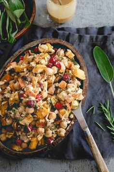 This chickpea fall salad is a hearty vegetarian meal with roasted sweet potatoes, delicata squash, cranberries, feta and a maple tahini dressing. | #HalfCupHabit #JustAddPulses #sponsored