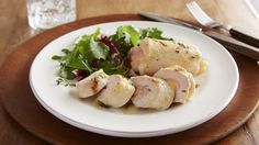 Grill a favorite combo, ham and cheese rolled up inside another favorite--chicken breasts!