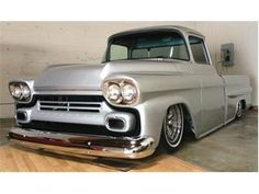 "1958 Chevy Apache Fleetside:  Custom, all shaved, new Mercedes silver paint, ground up restoration, 350 Chevy crate, with RV cam 2000 miles on it, 350 trans, holley carb, headers, Accuair airbag system, installed by Skoty chops customs. Disk brakes 15"" torque thrust. Frame notched and boxed by Gambino Kustoms. New black cloth and vinyl interior combo.  See more at ClassicCars.com"