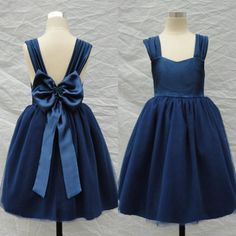 The flower girl tutu dress which match the flowers- dark blue flower girl dresses square sleeveless communion dresses tea length tulle pageant dresses for girls backless with a bow is offered in forever_love_u and on DHgate.com flowergirl dresses uk along with girl white dress are on sale, too.