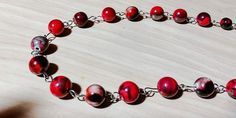 Red and black beaded necklace with silver chain. Each bead has a different design. Unique and beautiful! by tonispretties on Etsy