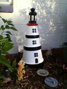 This is a Clay pot Lighthouse that I created (MimiRose), with IKEA lantern on top - holds one tealight candle Clay Flower Pots, Flower Pot Crafts, Clay Pots, Clay Pot Projects, Clay Pot Crafts, Crafts To Make, Craft Projects, Craft Ideas, Clay Pot Lighthouse
