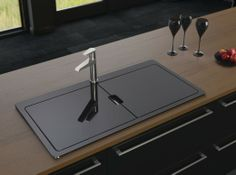 You may remember my last blog was all about concealed kitchens… well the trend has now found its way into sinks too, with designs that are hidden beneath a glass cover for a sleek, streamlined look. Astracast's Vantage Sio sink in black glass and brushed steel is a perfect example and the glass covers can also double as a chopping board or drainer, so you can increase workspace in the kitchen at the same time.