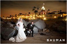 We love the lighting on this couple and Hotel Del Coronado in the background!   Photography by Bauman Photographers. View More:  http://baumanphotographers.com/blog/weddings/2013/06/coronado-community-center-wedding-coronado-ca/