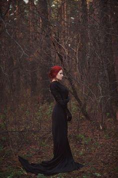 Red hair. Black Dress