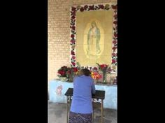Miss Kate prays to Jesus Christ at St. Gregory Catholic Church in Phoenix.