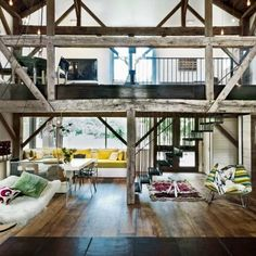 A RUSTIC 19TH CENTURY FARMHOUSE IN THE HAMPTONS, UPDATED BY ADDING A BARN EXTENSION, RESTORING UNTREATED WOOD BEAMS & RECLAIMED WOOD FLOOR BOARDS ~