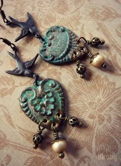 Earrings made with mismatched verdigris'd hearts, sweet little bird charms and vintage beads