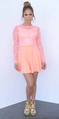 Jennifer Lopez made an entrance at the American Idol taping in a two-toned neon scallop lace Asos skater dress, amping her look even further with rose gold mirrored fluoro-embroidered Sophia Webster sandals.