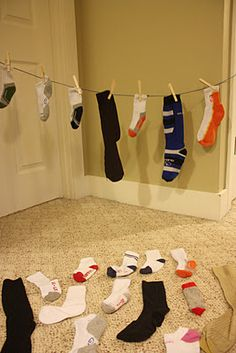 Sock matching game using clothesline, clothespins, and lots of pairs of socks. Cute in home-living/dramatic play area