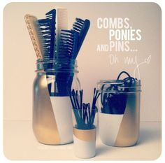 mason jars and a shot glass for hair combs, ponytail holders, and bobby pins